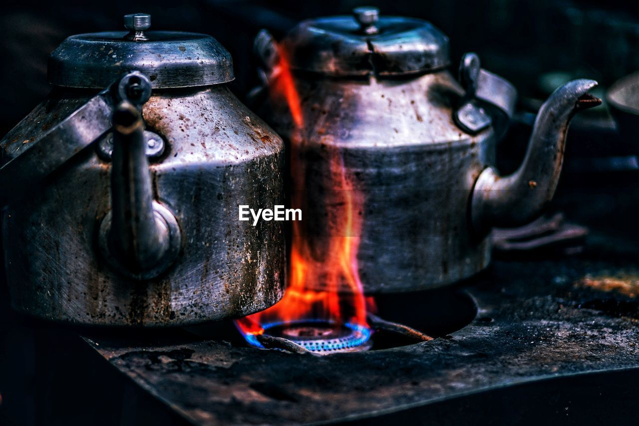 heat - temperature, burning, fire, flame, fire - natural phenomenon, metal, household equipment, close-up, stove, kitchen utensil, focus on foreground, glowing, preparation, appliance, no people, indoors, food and drink, nature, still life, camping stove, silver colored