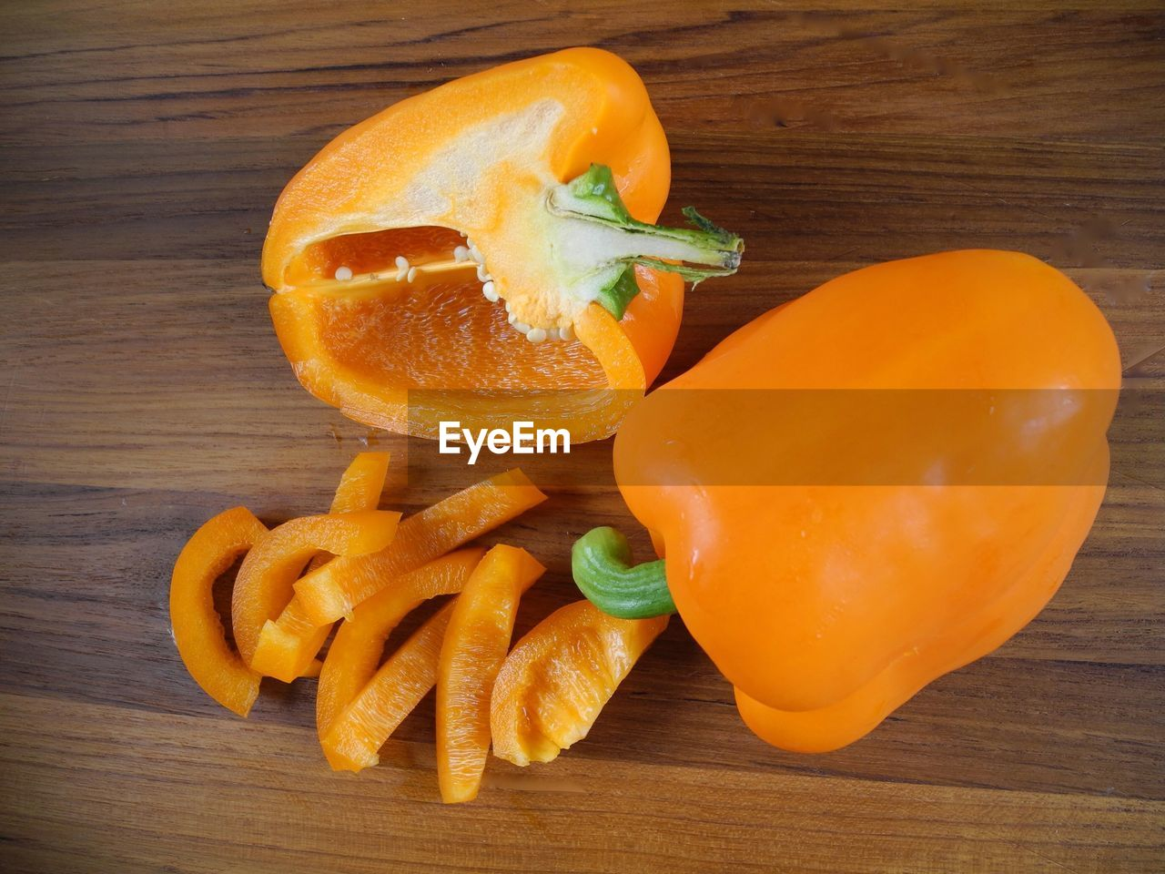 Close-up of orange bell peppers on cutting board