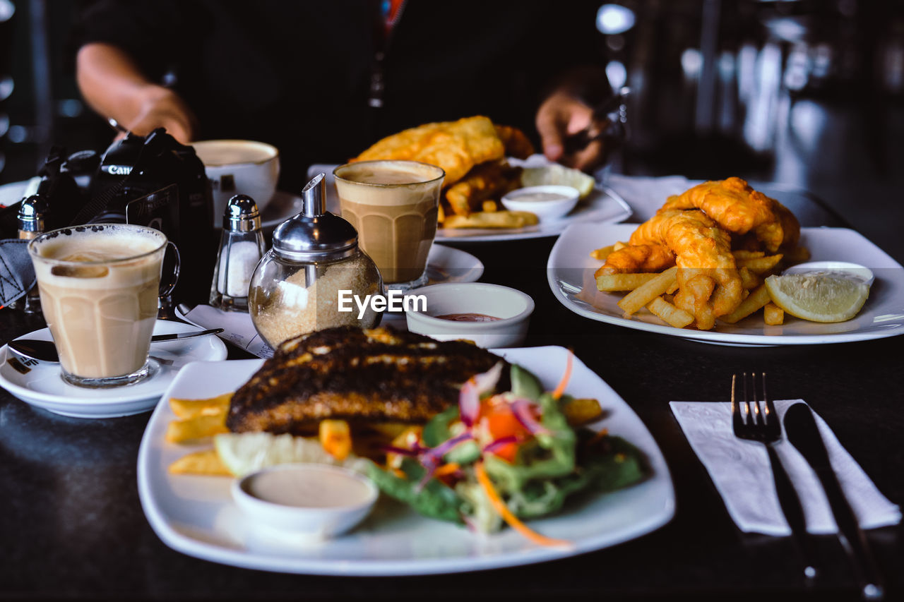 Close-Up Of Food And Coffee Served On Table