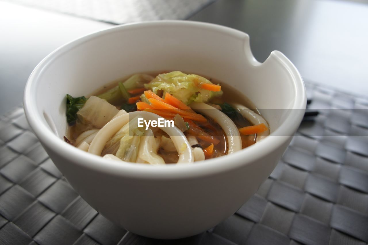 Close-up of ramen noodles served in bowl on table
