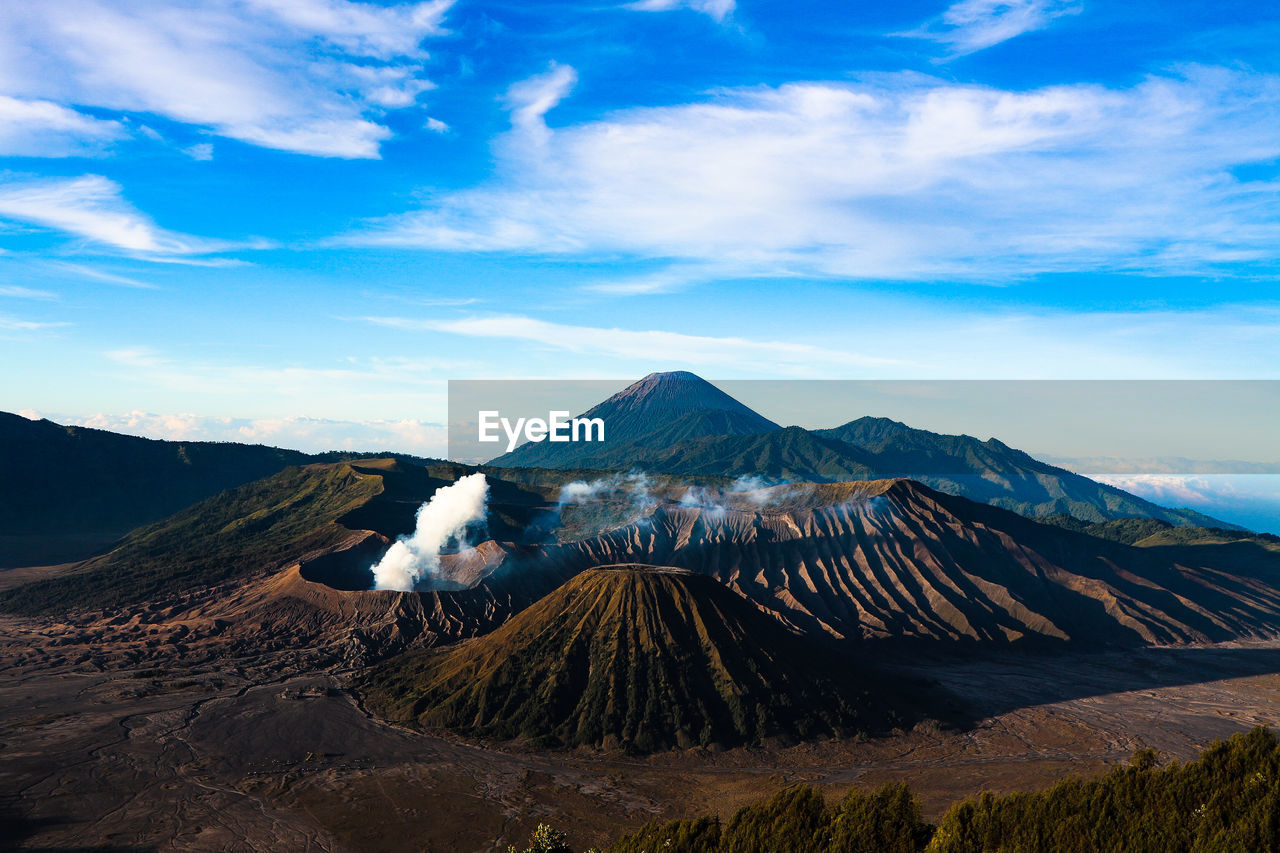 Scenic view of mountain range against cloudy sky in east java indonesia