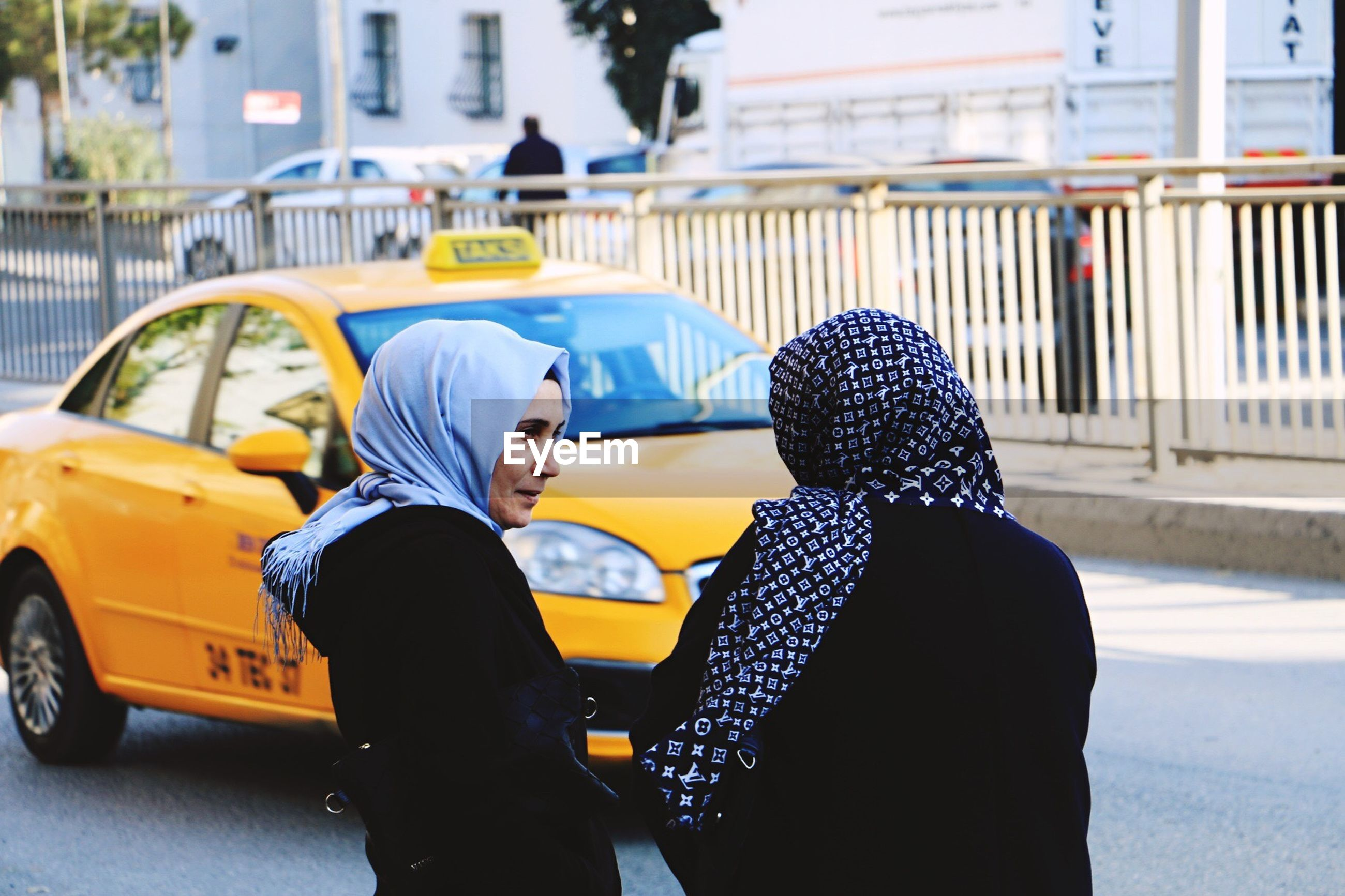 two people, car, street, taxi, couple - relationship, heterosexual couple, love, togetherness, city, males, young women, young adult, yellow taxi, adults only, city street, romance, women, females, men, city life, lifestyles, adult, people, outdoors, happiness, friendship, couple, real people, day