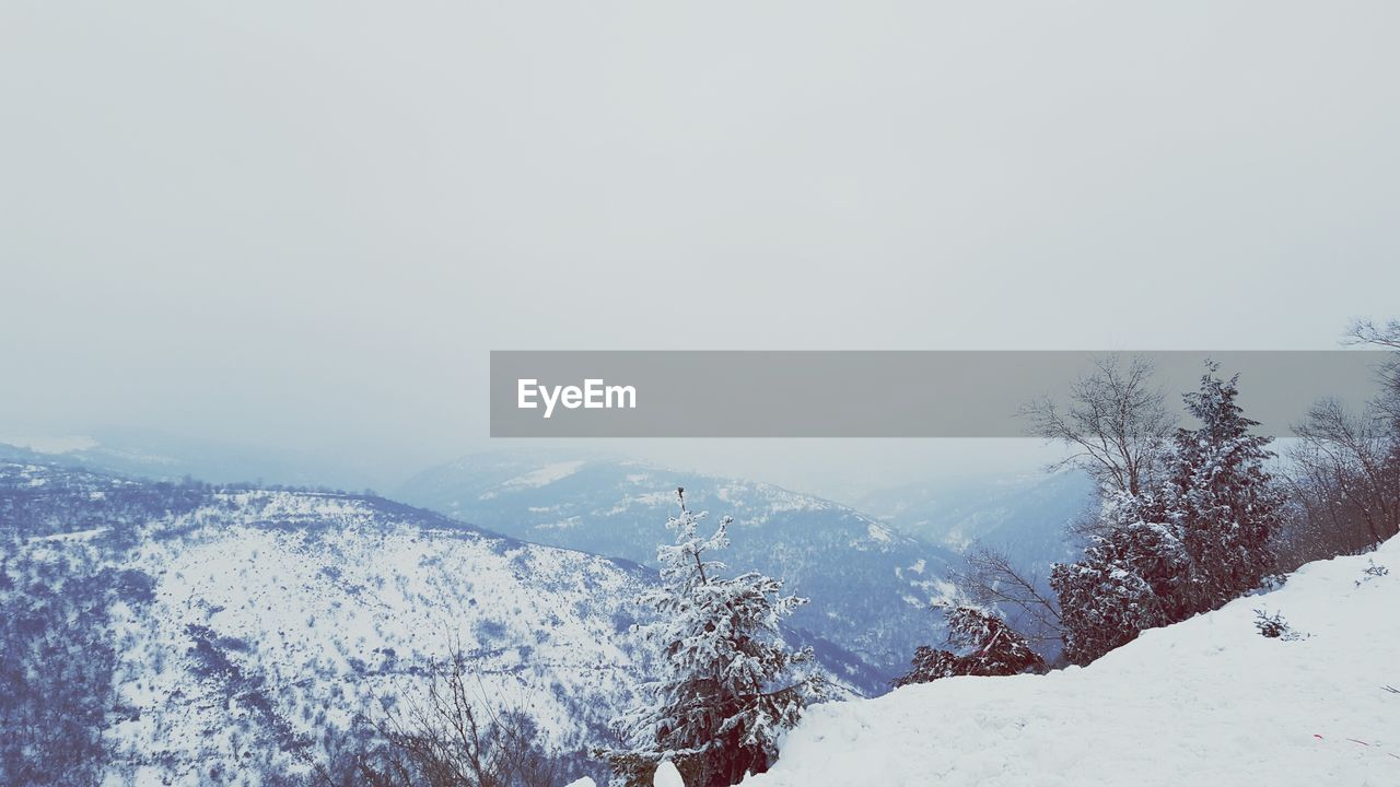 snow, winter, cold temperature, weather, nature, beauty in nature, scenics, mountain, no people, tranquility, tranquil scene, outdoors, landscape, day, mountain range, sky, range