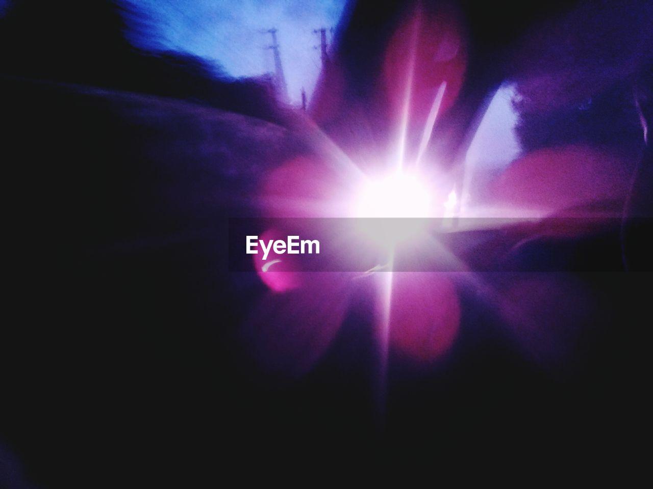 lens flare, sun, light beam, illuminated, low angle view, indoors, spotlight, solar eclipse, no people, nature, close-up, astronomy, sky