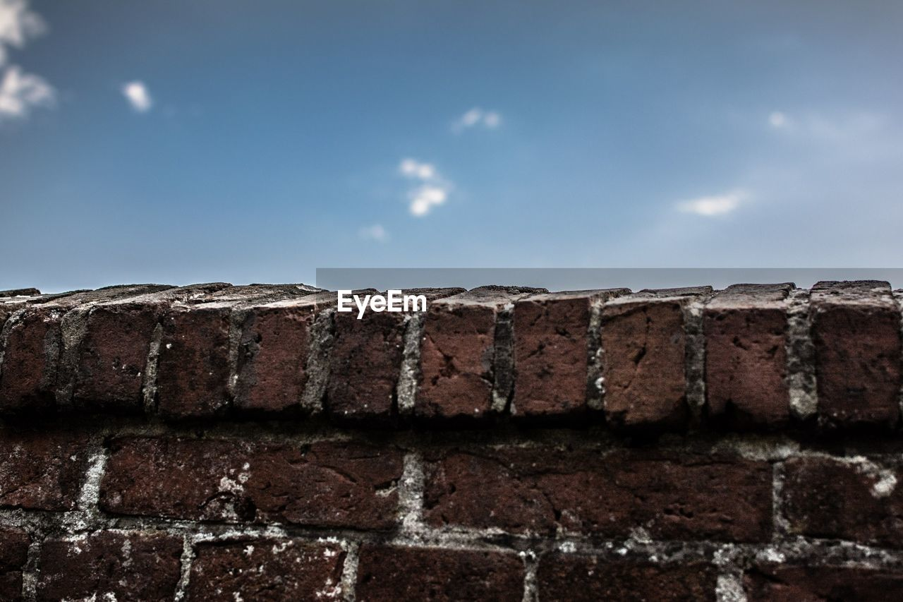 View Of Brick Wall And Blue Sky
