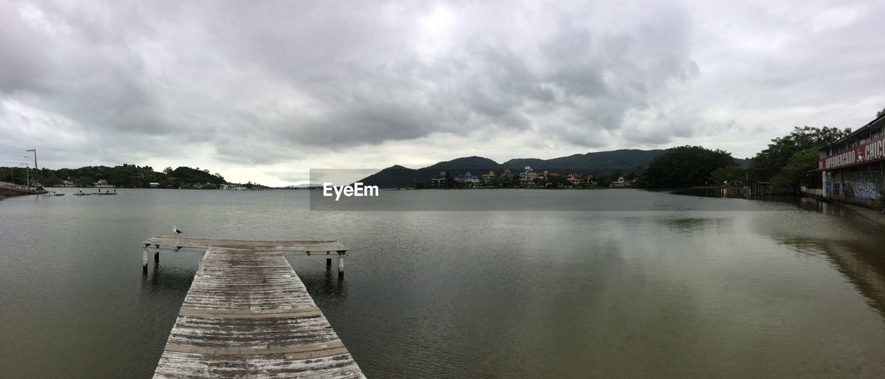 water, sky, cloud - sky, architecture, built structure, nature, pier, no people, scenics - nature, lake, beauty in nature, direction, tranquil scene, mountain, tranquility, jetty, the way forward, outdoors