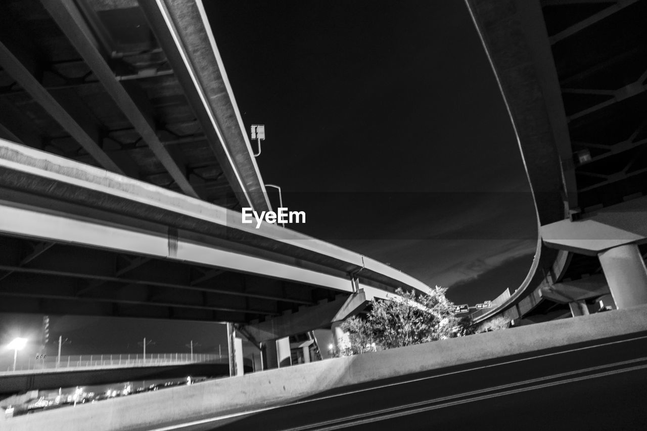 architecture, built structure, bridge, connection, transportation, bridge - man made structure, road, elevated road, no people, city, night, building exterior, nature, low angle view, highway, railing, outdoors, sky, illuminated, architectural column, overpass, multiple lane highway