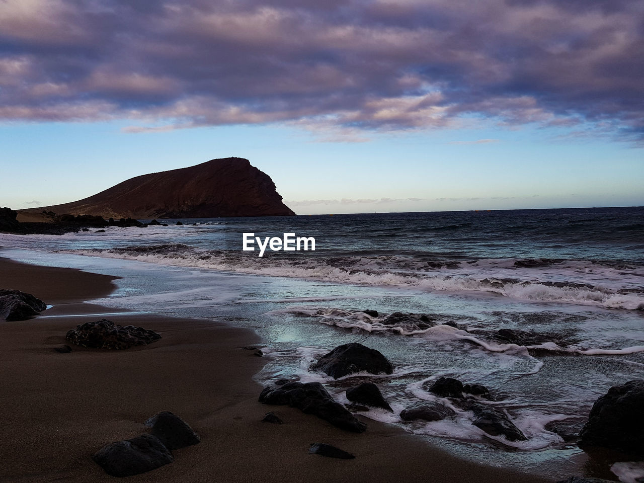 sea, sky, beach, land, water, cloud - sky, beauty in nature, horizon over water, scenics - nature, rock, horizon, tranquil scene, tranquility, rock - object, solid, sunset, motion, sport, no people, outdoors, stack rock