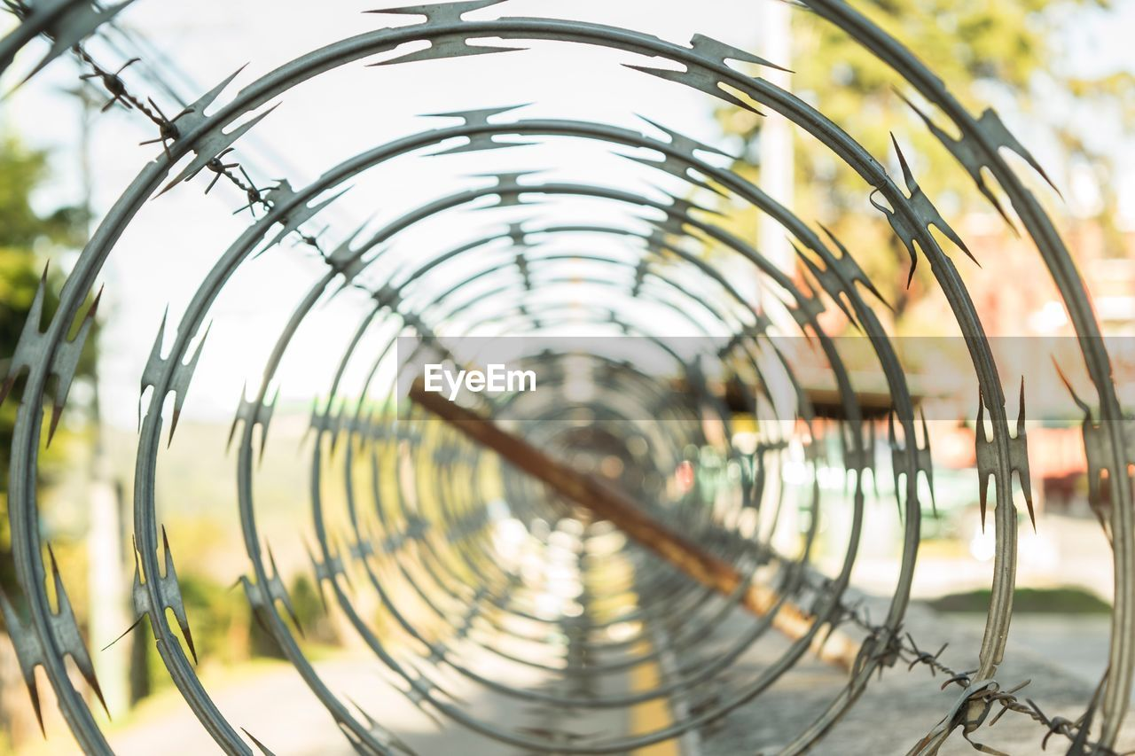 metal, protection, safety, no people, spiral, day, outdoors, close-up, bicycle rack