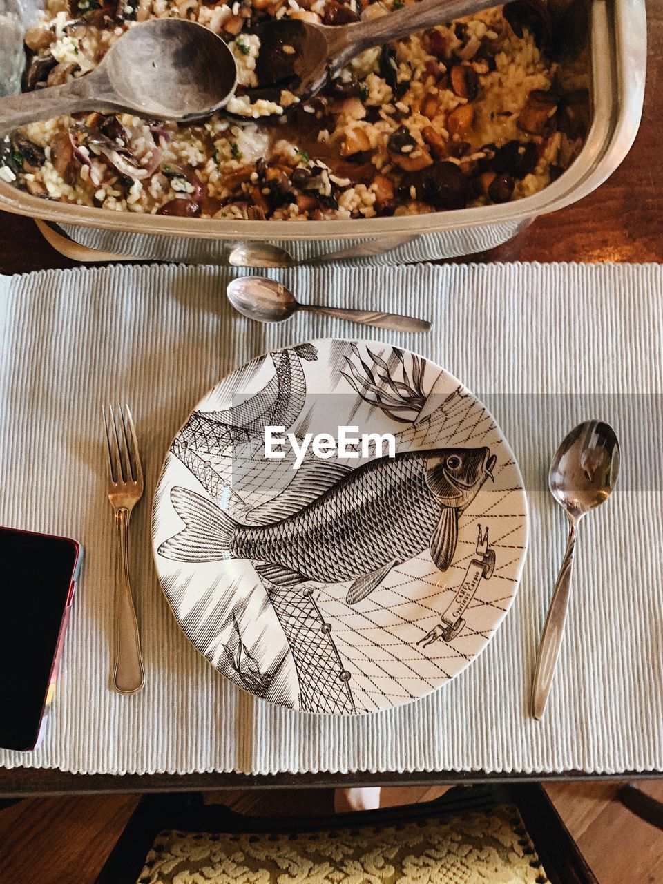 table, kitchen utensil, eating utensil, spoon, indoors, wood - material, still life, no people, food and drink, high angle view, napkin, food, household equipment, fork, close-up, freshness, directly above, place setting, knife, textile, table knife, setting, silver colored, place mat