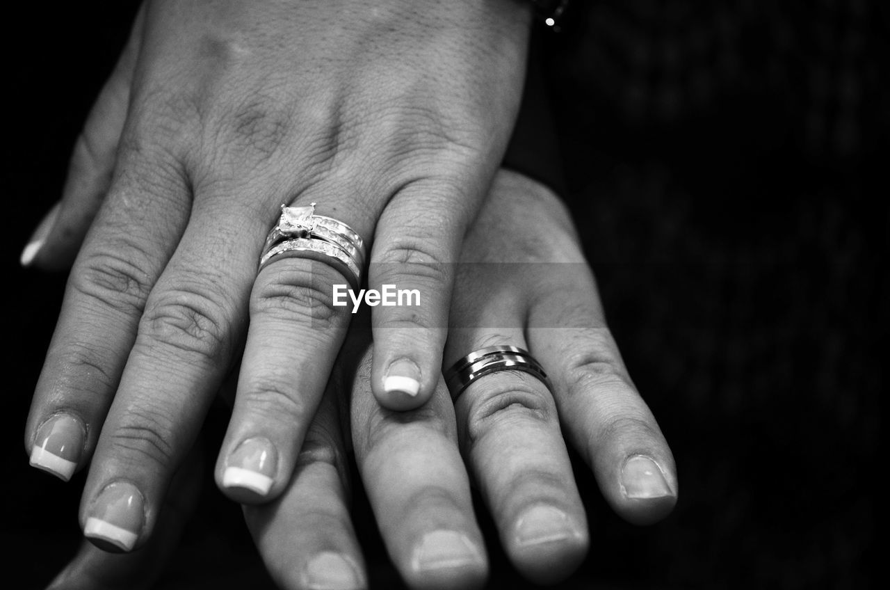 Cropped Image Of Hands Wearing Wedding Rings