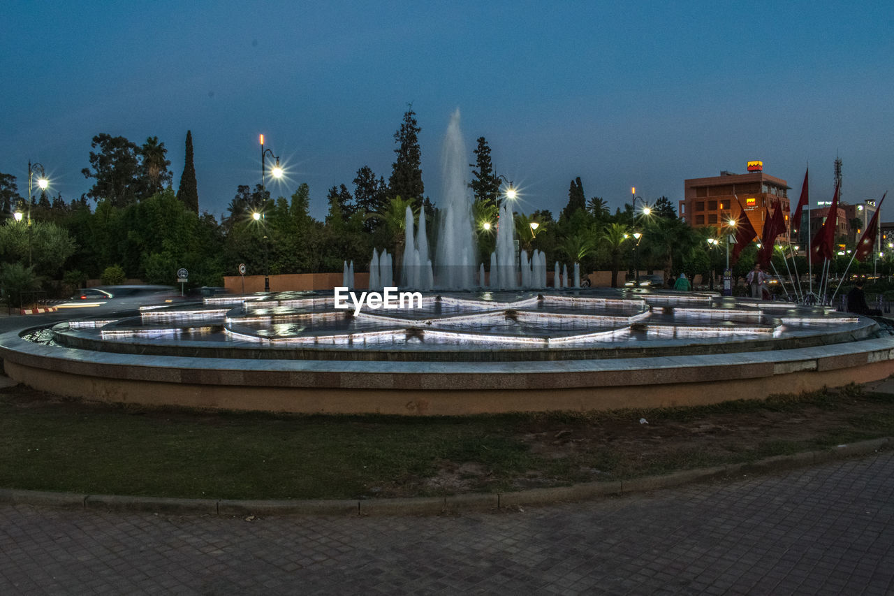 FOUNTAIN IN PARK AT NIGHT