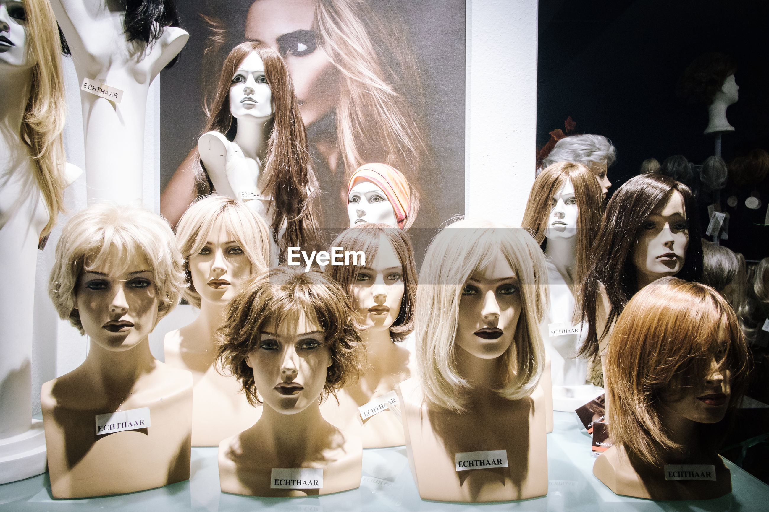 Wigs on mannequins in store
