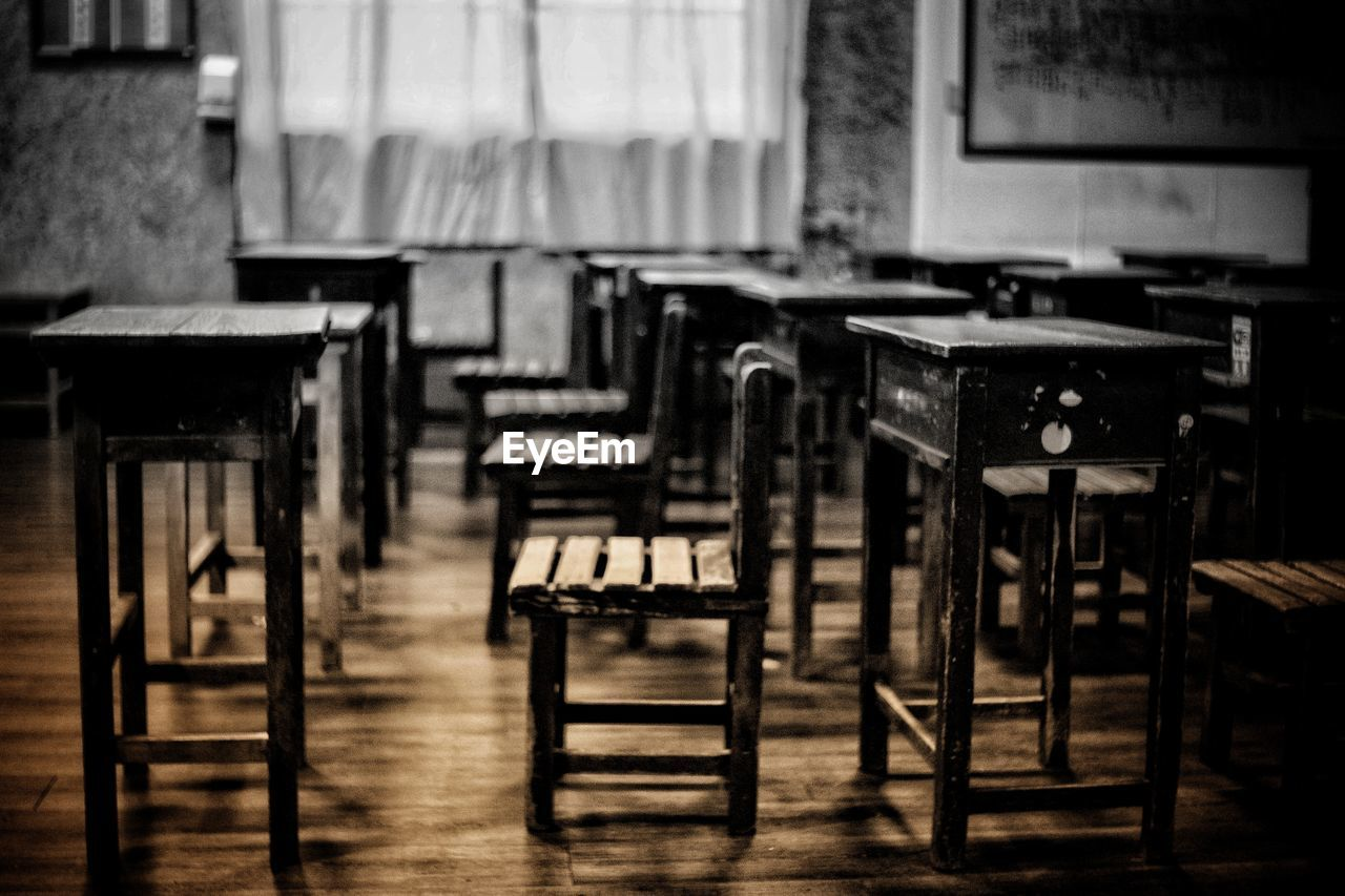 seat, chair, table, absence, indoors, empty, classroom, school, wood - material, no people, furniture, education, focus on foreground, day, flooring, in a row, group, wood, arrangement