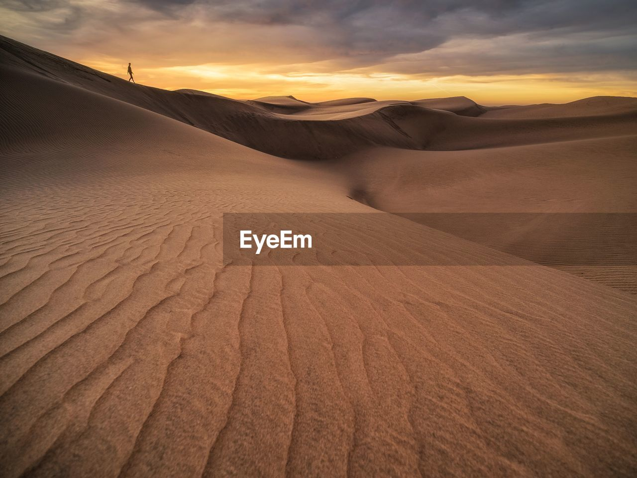desert, scenics - nature, sand dune, landscape, sand, arid climate, climate, land, tranquility, sky, tranquil scene, environment, beauty in nature, sunset, non-urban scene, remote, nature, no people, cloud - sky, extreme terrain, outdoors, atmospheric
