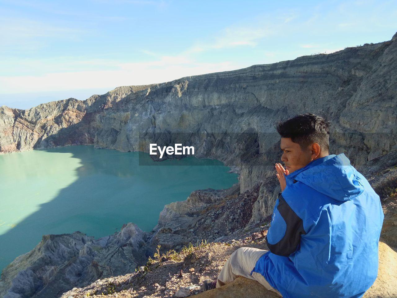 Hiker Sitting On Mountain