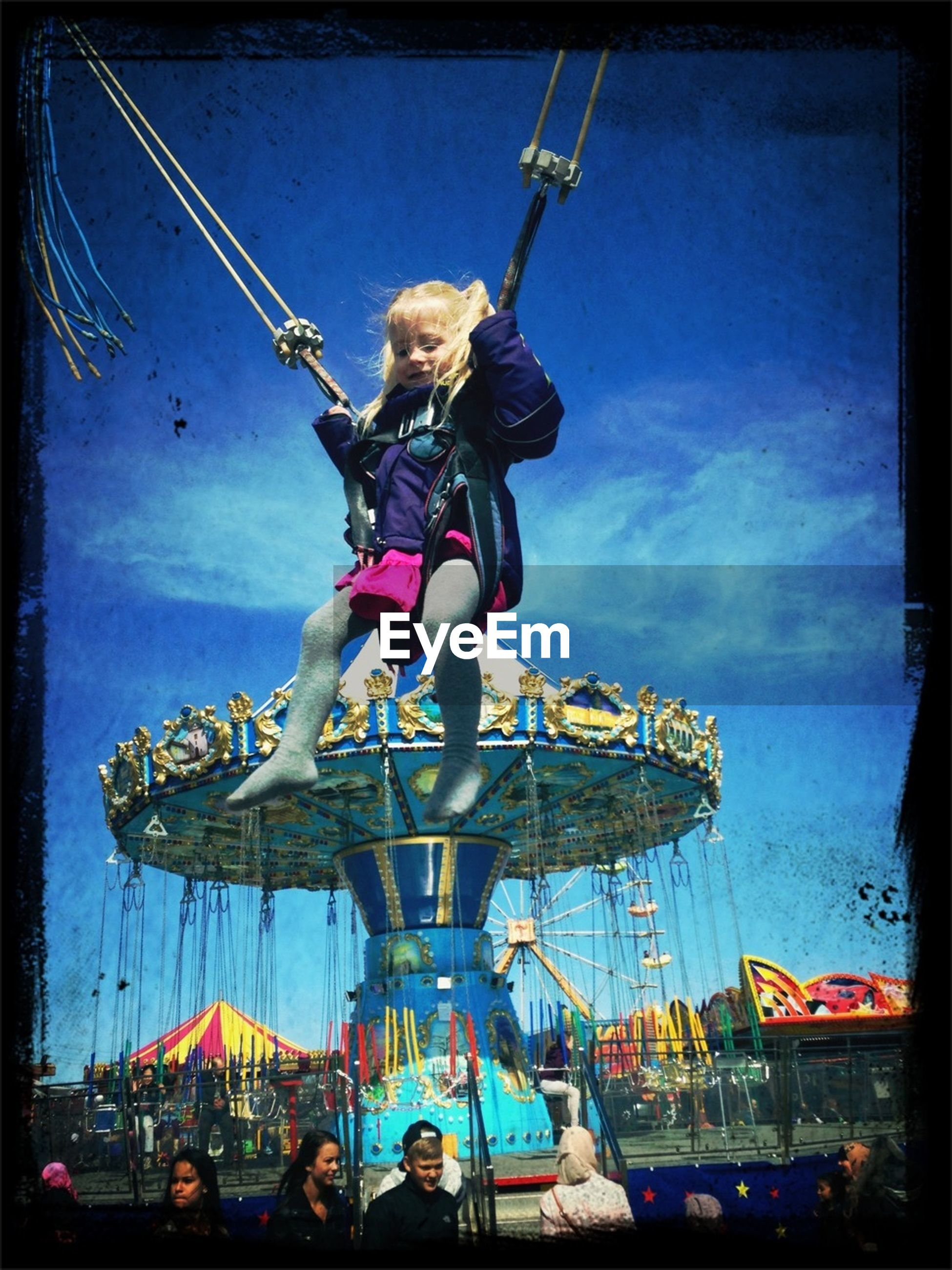 transfer print, leisure activity, lifestyles, full length, auto post production filter, enjoyment, fun, men, blue, arts culture and entertainment, sky, playing, amusement park, excitement, childhood, performance, boys, casual clothing