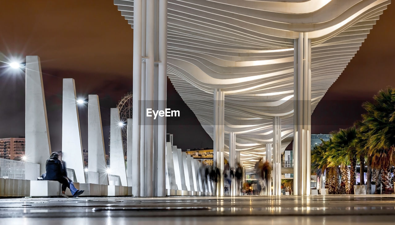 architecture, architectural column, indoors, built structure, illuminated, pillar, travel destinations, real people, modern, day