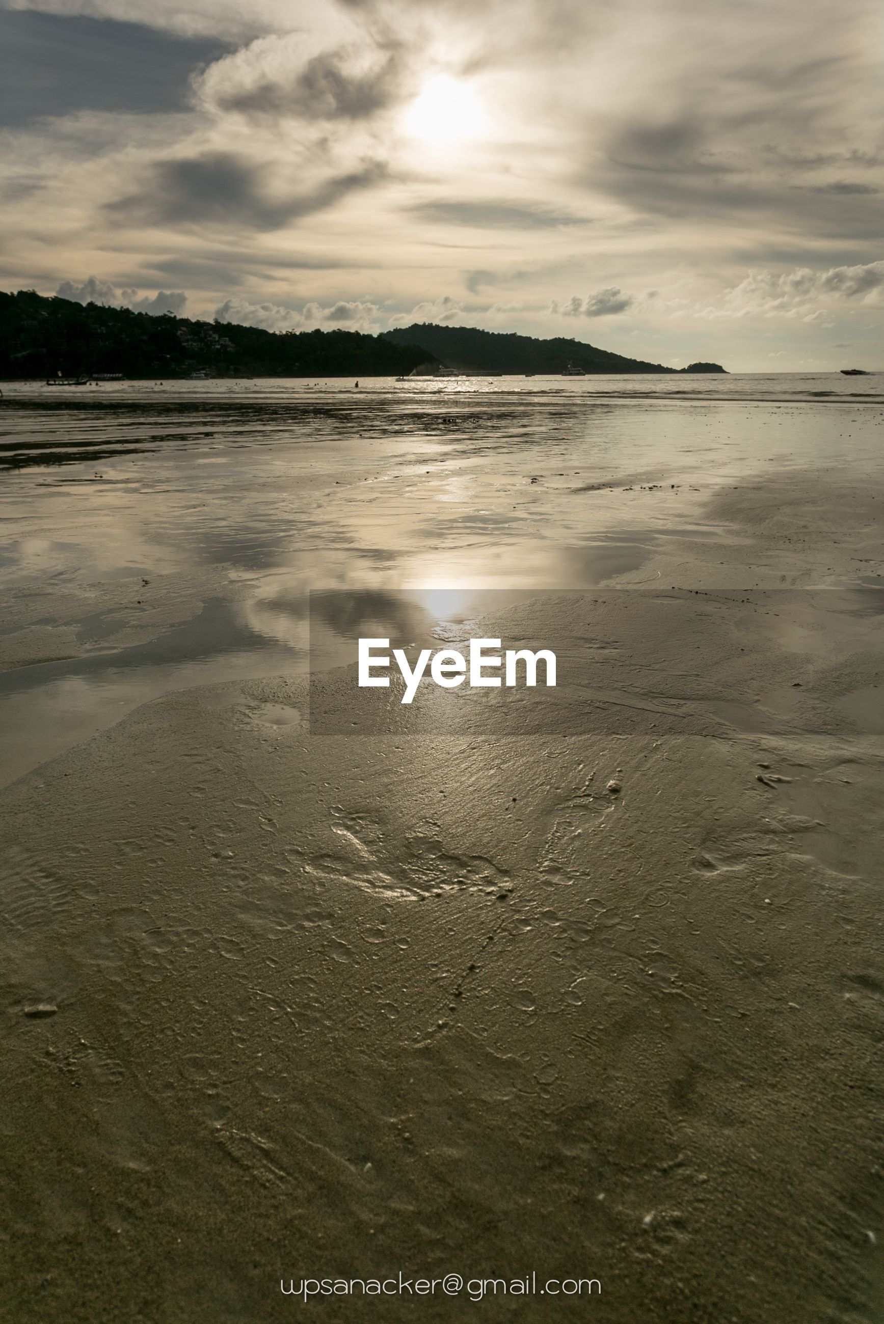 water, sun, tranquil scene, tranquility, sky, scenics, reflection, beauty in nature, beach, sunset, sea, sunlight, cloud - sky, nature, sunbeam, shore, idyllic, sand, waterfront, cloud