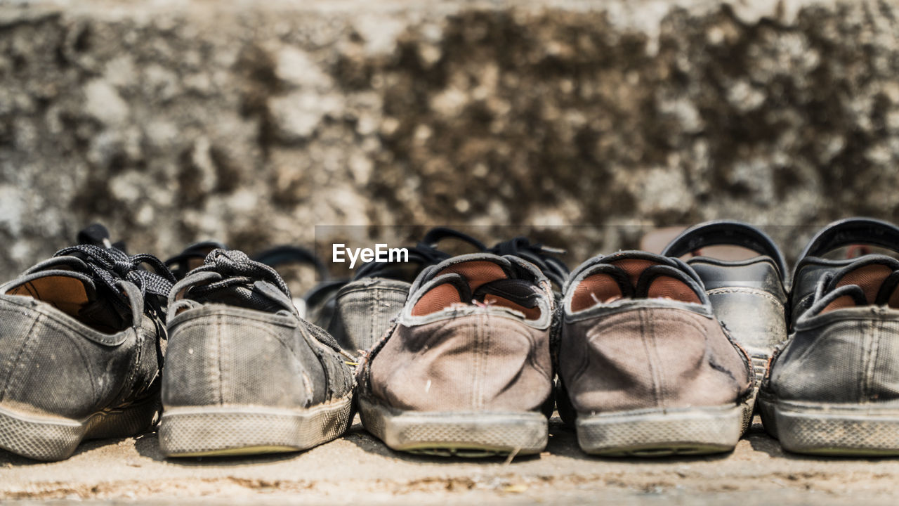 shoe, no people, focus on foreground, outdoors, nature, still life, day, sunlight, absence, close-up, travel, pair, side by side, architecture, land, solid, in a row, tourism, leather, personal accessory