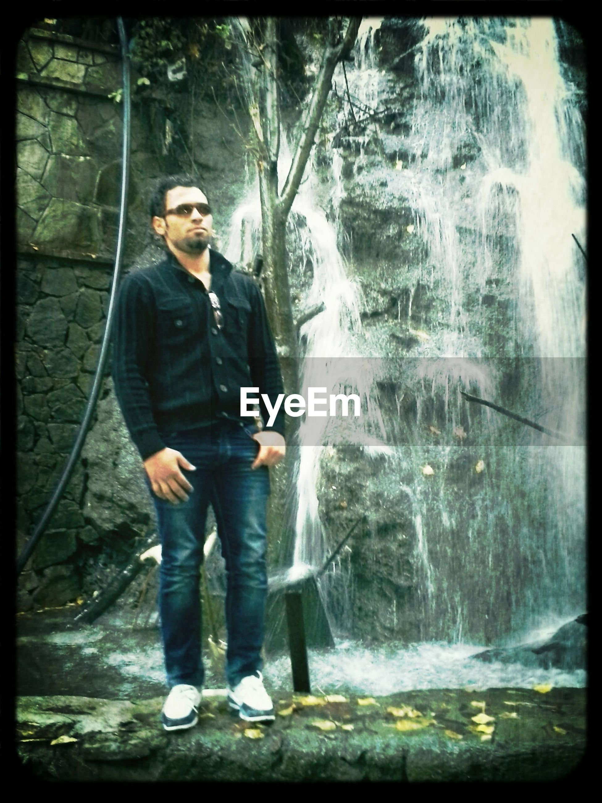 lifestyles, transfer print, leisure activity, standing, water, full length, casual clothing, young adult, auto post production filter, person, looking at camera, front view, portrait, young men, three quarter length, reflection, day