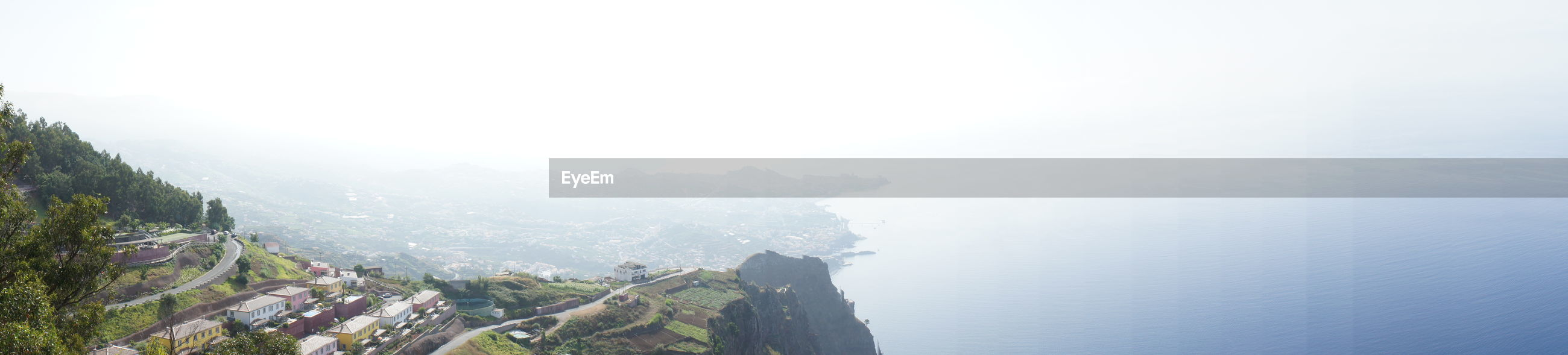 fog, scenics, mountain, beauty in nature, tranquil scene, tranquility, copy space, nature, foggy, water, weather, idyllic, high angle view, sky, sea, day, landscape, non-urban scene, outdoors