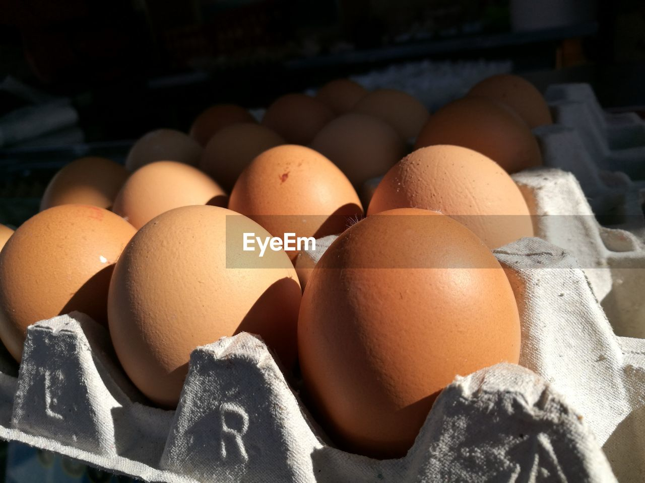 egg, food and drink, wellbeing, food, healthy eating, egg carton, freshness, brown, no people, close-up, still life, raw food, large group of objects, focus on foreground, indoors, market, crate, fragility, box, container