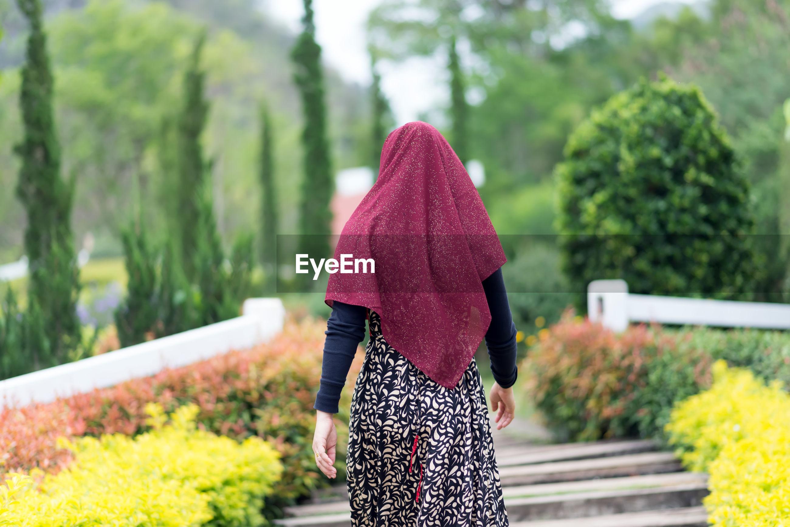 Rear view of woman in hijab walking at park