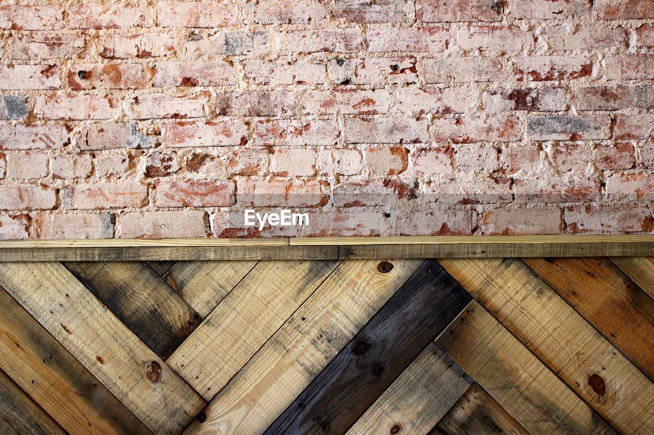 Wooden plank and brick wall