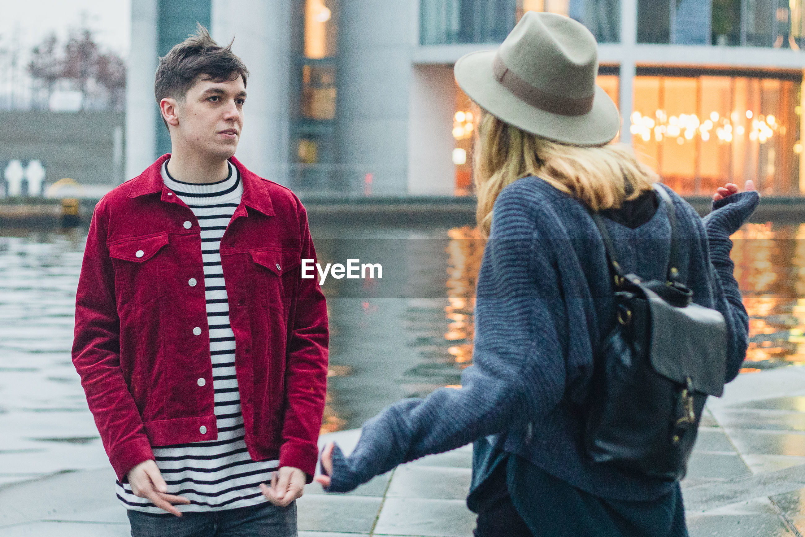 Young couple quarreling in city