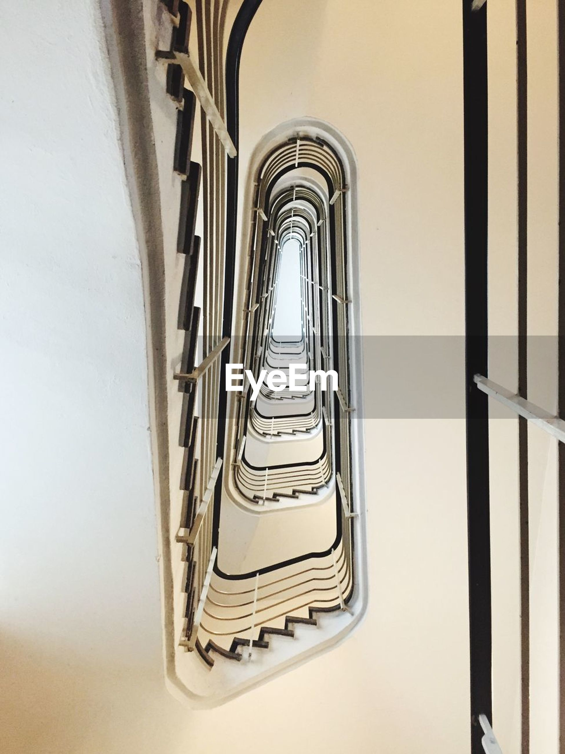 architecture, built structure, railing, indoors, no people, staircase, steps and staircases, day, building, low angle view, spiral, in a row, diminishing perspective, metal, spiral staircase, directly below, window, the way forward, pattern, repetition