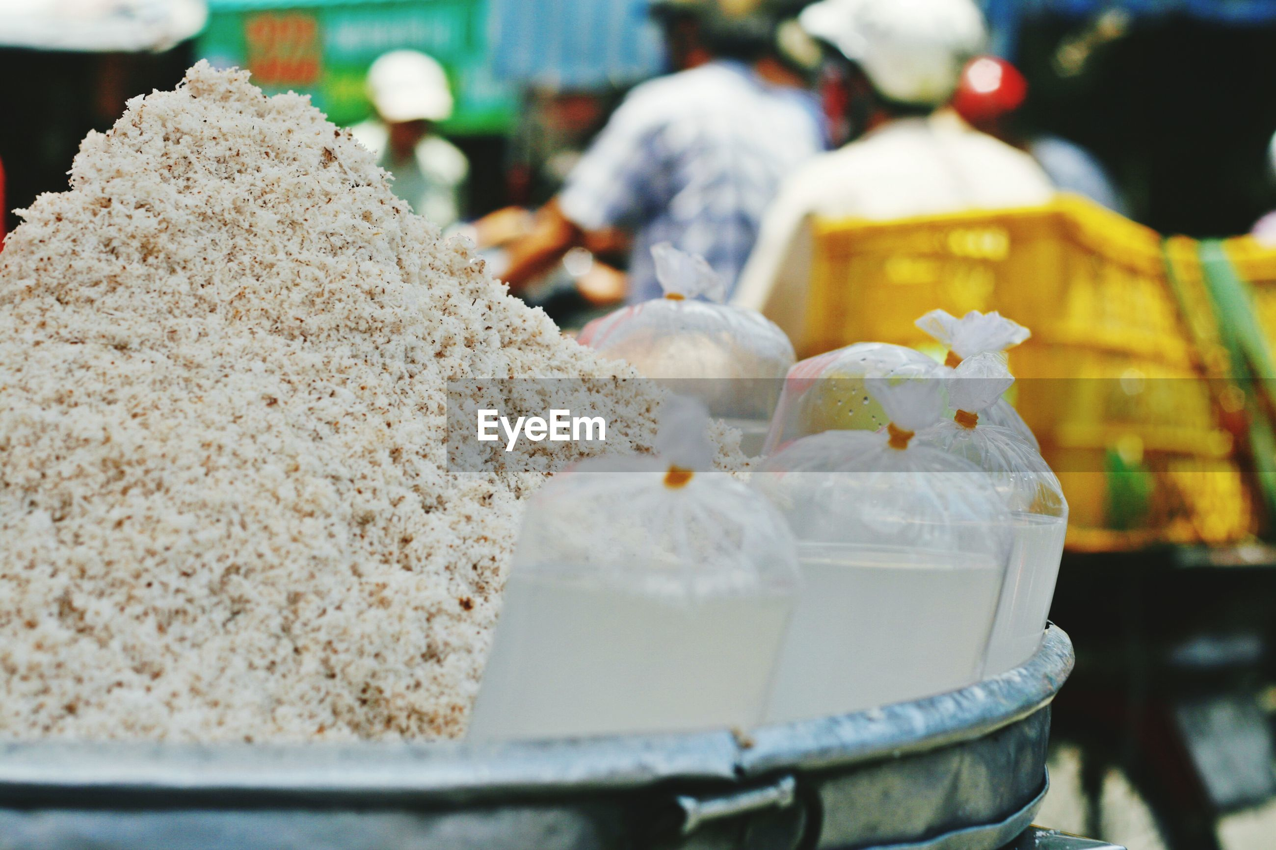 Shredded coconut and juice for sale at market