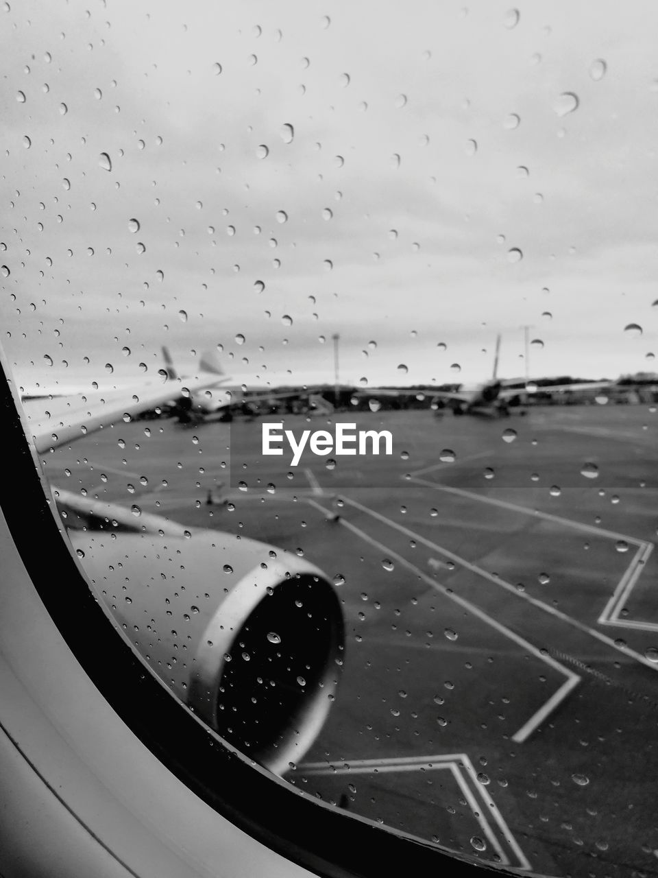 glass - material, drop, window, airplane, water, wet, air vehicle, no people, close-up, transportation, full frame, sky, mode of transport, indoors, backgrounds, runway, airport, vehicle part, day, airplane wing