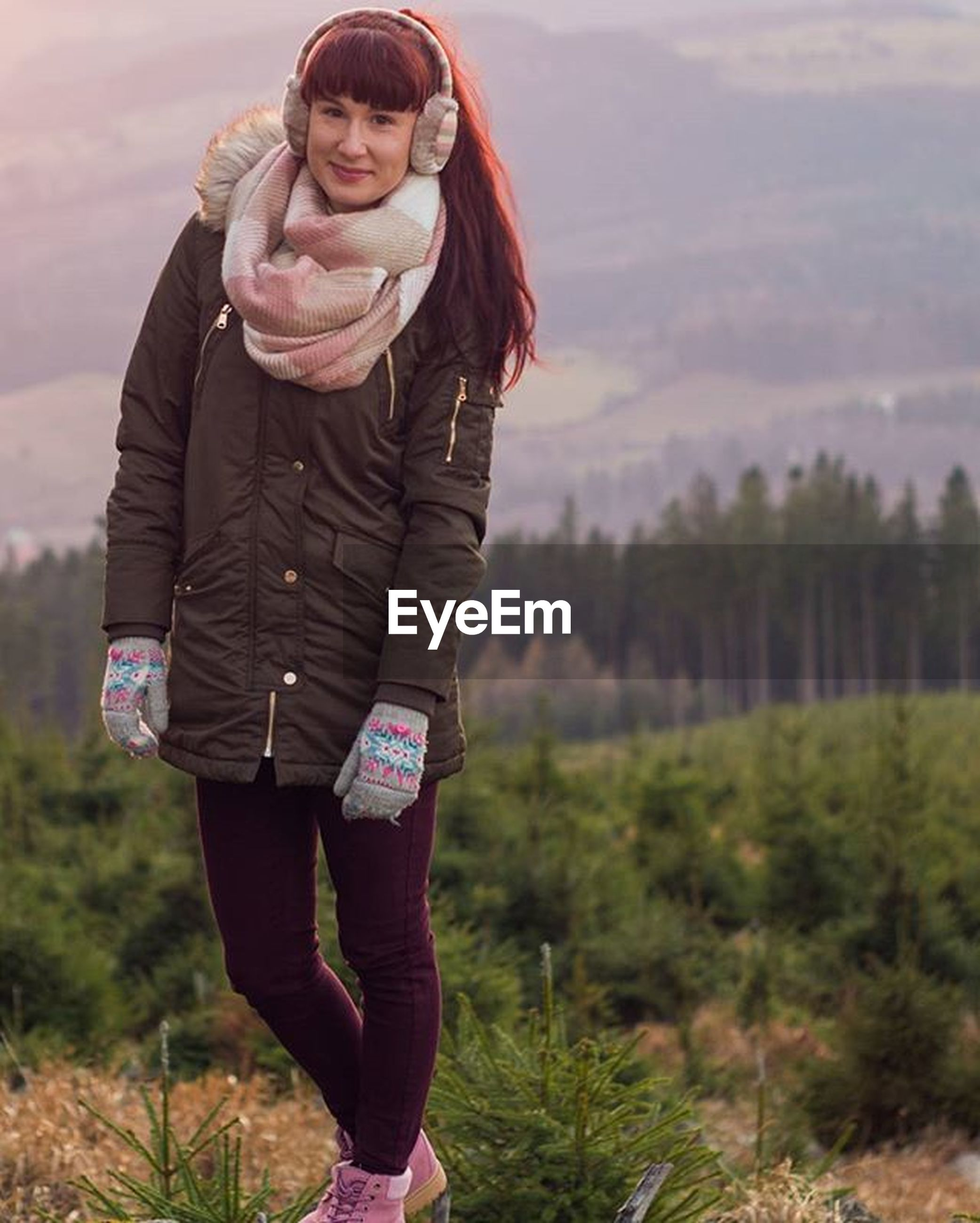 young adult, casual clothing, lifestyles, person, leisure activity, standing, looking at camera, portrait, front view, three quarter length, young women, smiling, field, focus on foreground, full length, happiness