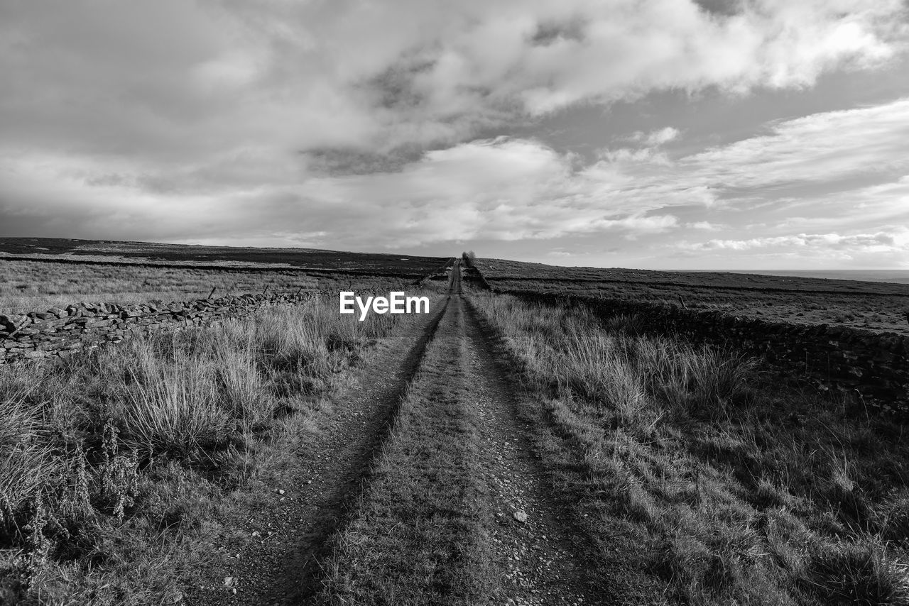 cloud - sky, sky, land, landscape, the way forward, direction, diminishing perspective, tranquility, field, tranquil scene, environment, grass, nature, scenics - nature, vanishing point, horizon, beauty in nature, day, no people, plant, outdoors, trail