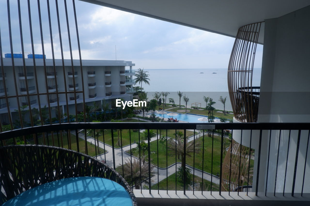 sky, architecture, built structure, water, nature, reflection, no people, day, indoors, glass - material, window, sea, railing, transparent, plant, tree, building, modern, luxury