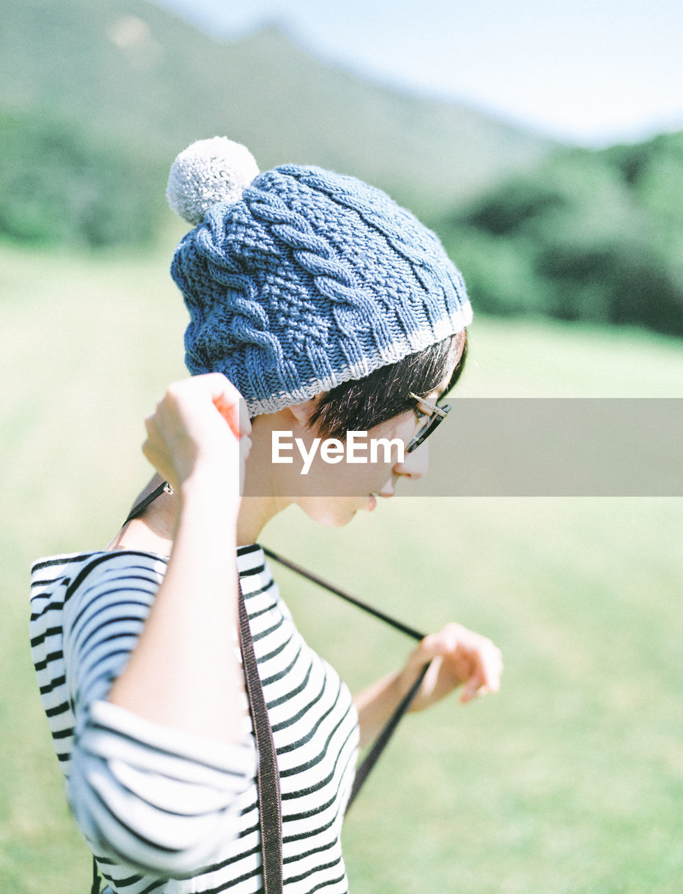 Woman wearing knit hat on field