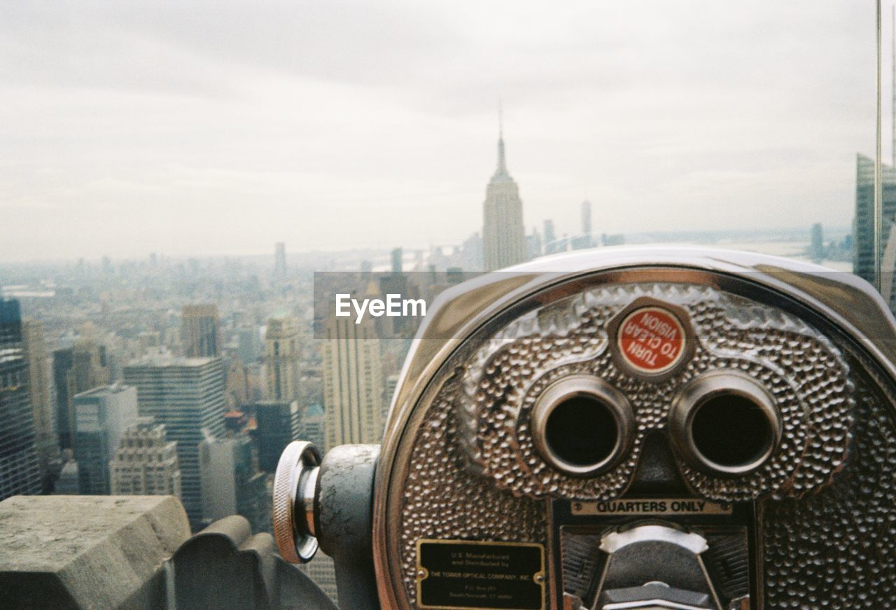 architecture, building exterior, built structure, city, binoculars, cityscape, sky, building, coin operated, coin-operated binoculars, travel destinations, skyscraper, travel, office building exterior, nature, tourism, observation point, day, no people, tall - high, outdoors, hand-held telescope, financial district