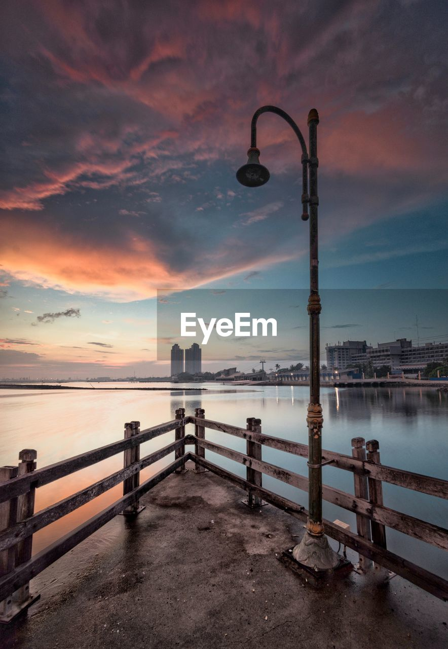 water, sky, sunset, cloud - sky, sea, beauty in nature, nature, scenics - nature, railing, pier, built structure, architecture, tranquil scene, no people, street light, tranquility, idyllic, outdoors, street, horizon over water