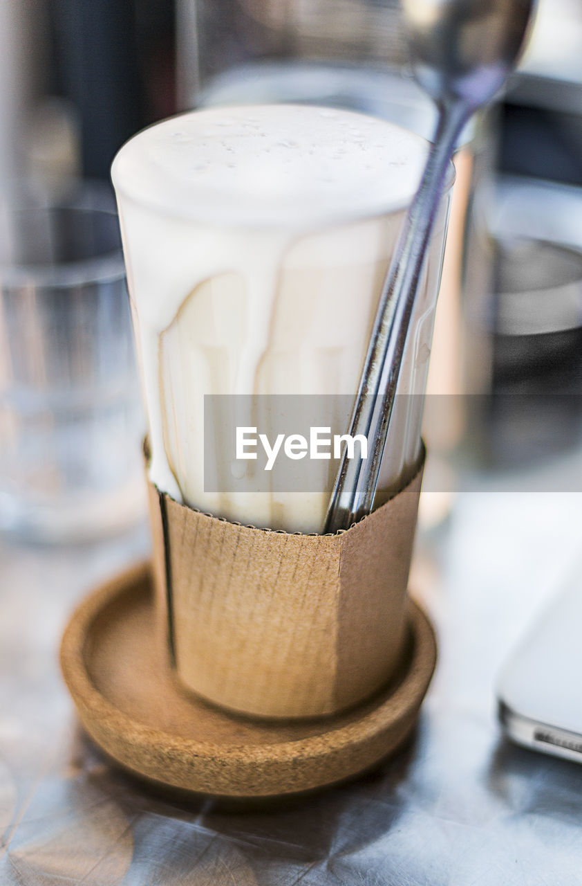 table, close-up, still life, indoors, no people, focus on foreground, food and drink, drink, container, household equipment, refreshment, selective focus, glass - material, transparent, drinking glass, glass, coffee - drink, food, freshness, white color