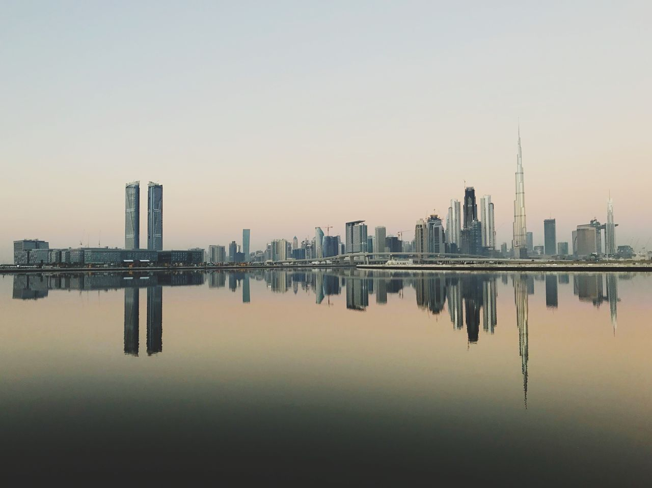 building exterior, sky, architecture, built structure, water, building, waterfront, reflection, city, office building exterior, skyscraper, urban skyline, landscape, tall - high, clear sky, nature, tower, no people, cityscape, outdoors, financial district, modern, spire