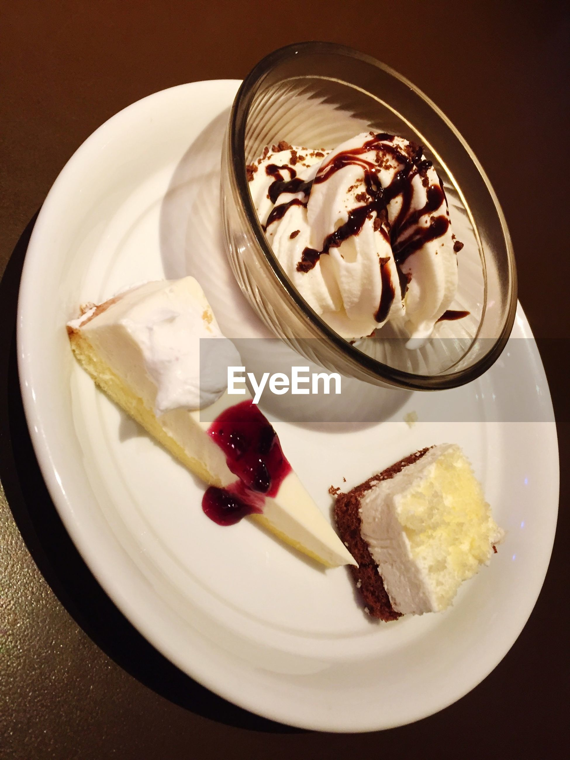 food and drink, food, freshness, sweet food, dessert, indoors, ready-to-eat, indulgence, plate, still life, unhealthy eating, temptation, ice cream, cake, strawberry, fruit, frozen food, table, close-up, serving size