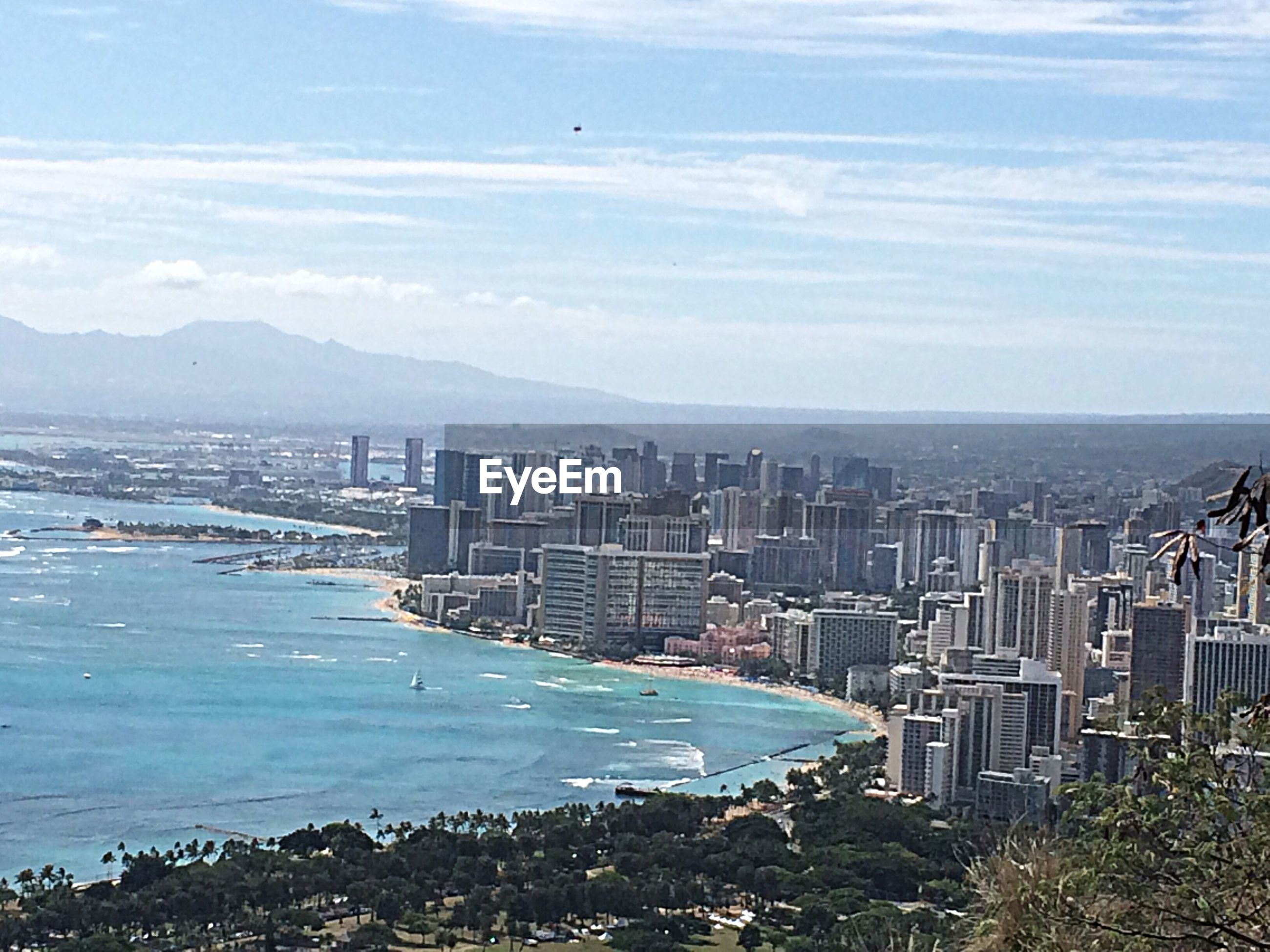 sea, water, architecture, city, building exterior, built structure, cityscape, sky, high angle view, coastline, skyscraper, mountain, beach, aerial view, crowded, day, nature, modern, scenics, outdoors