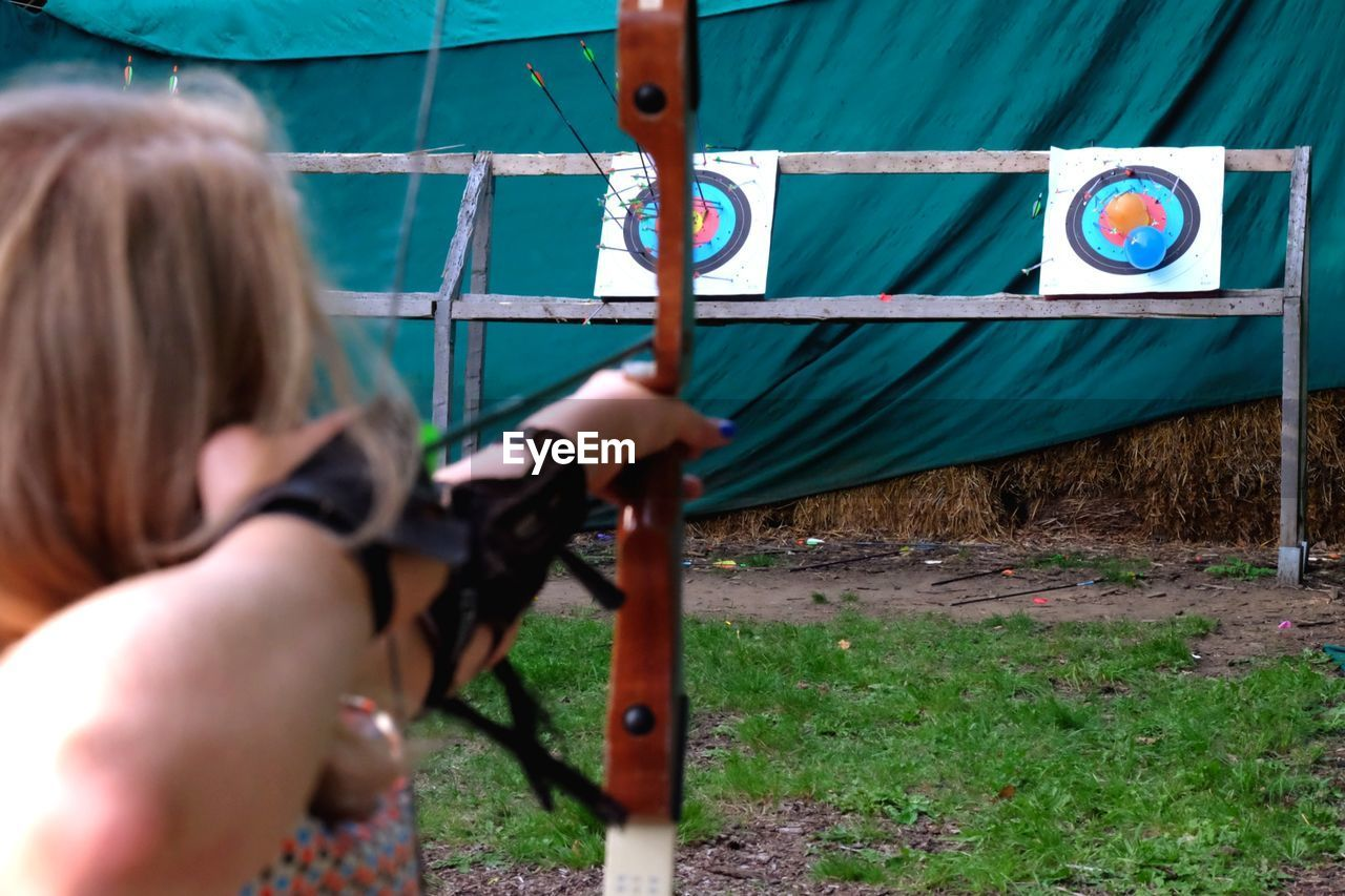 Woman Archer Aiming At Target