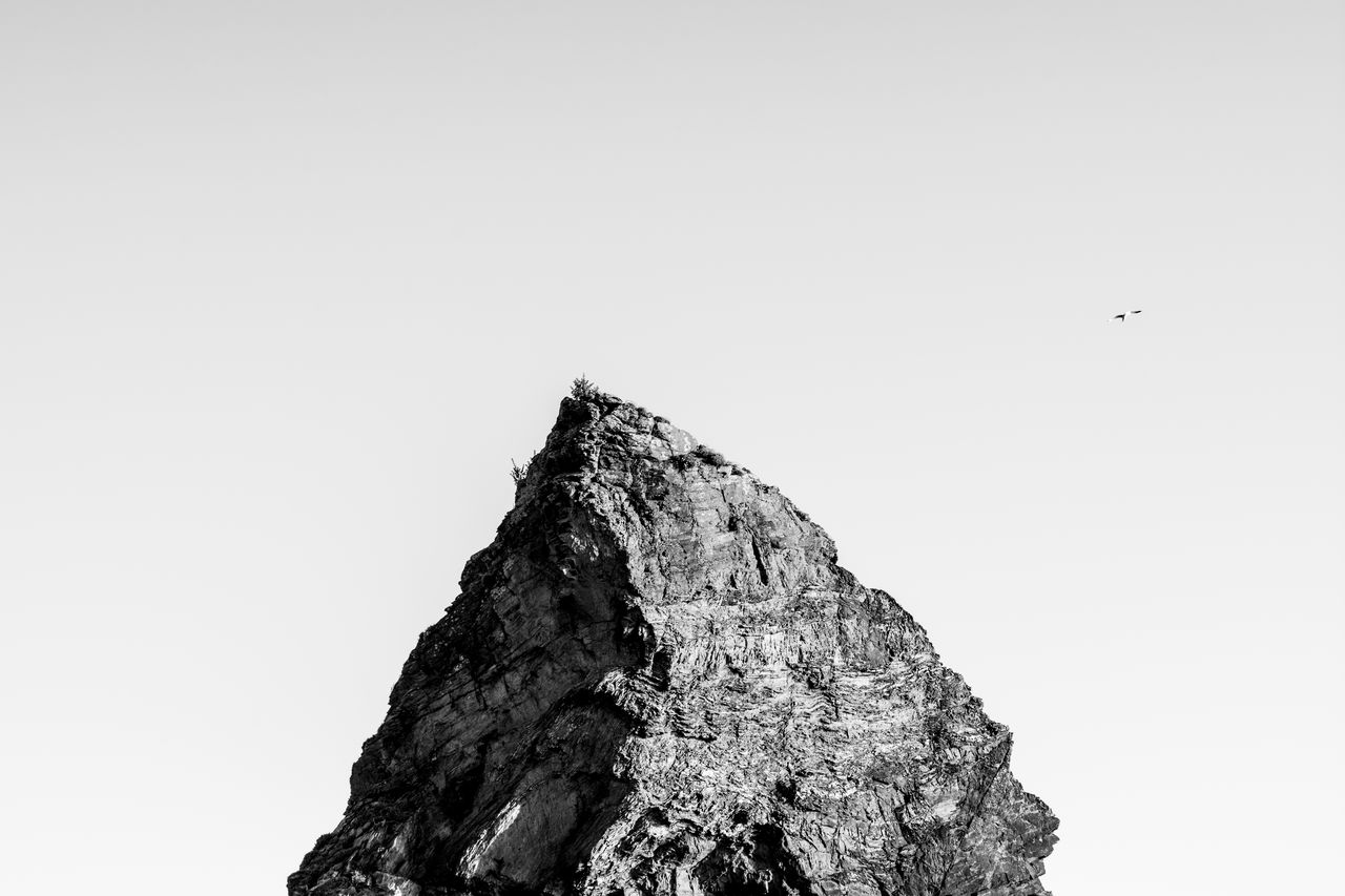 Low Angle View Of Rock Formation Against Clear Sky