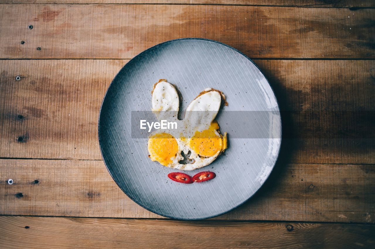 Directly Above Shot Of Bunny Shaped Fried Egg Served In Plate On Table