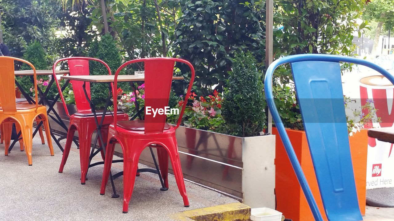 Chairs and table at sidewalk cafe