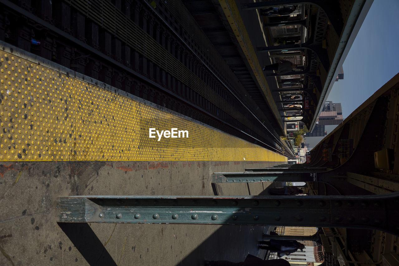 Tilt Image Of Railroad Station Platform During Sunny Day