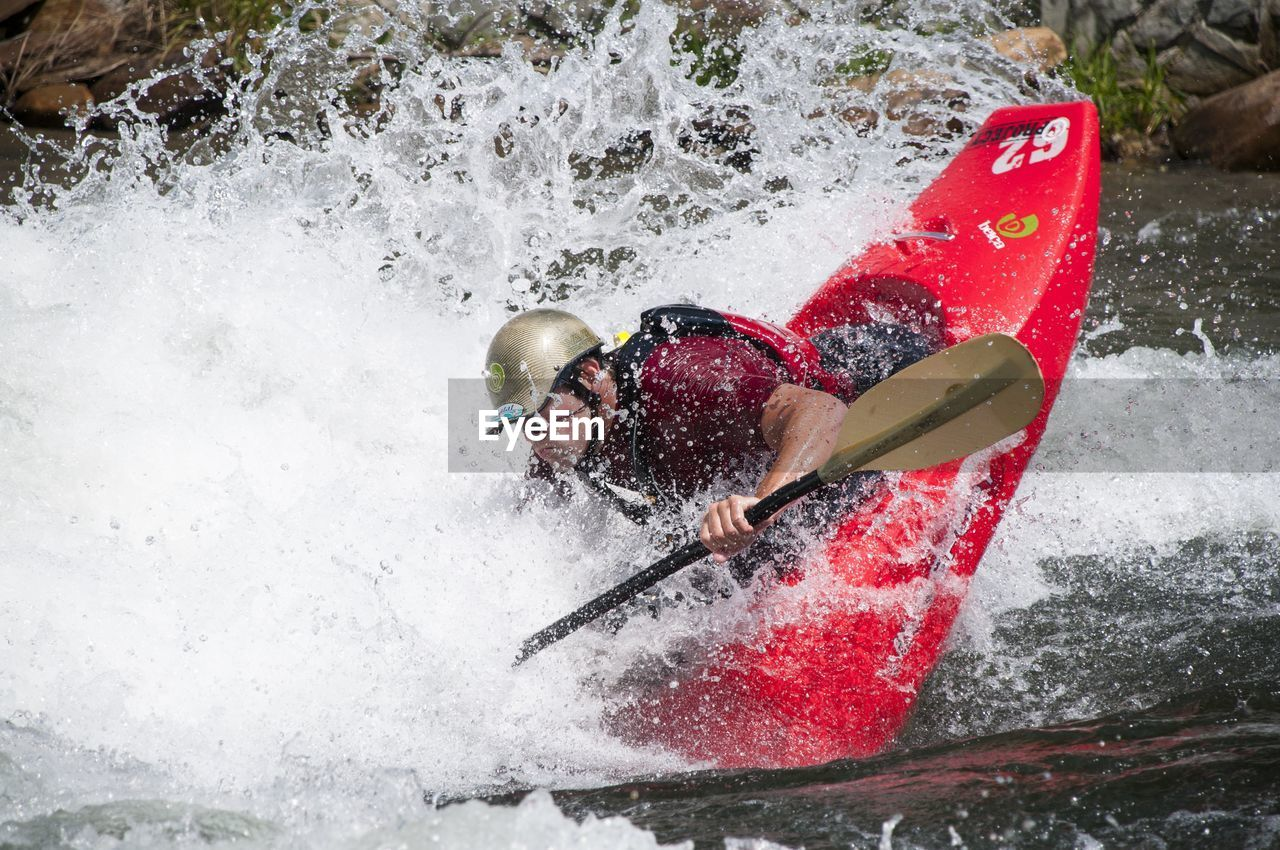 adventure, one person, motion, splashing, rapid, leisure activity, river, speed, one man only, nature, day, oar, outdoors, water, adults only, people, sport, vacations, real people, men, kayak, extreme sports, only men, adult, young adult