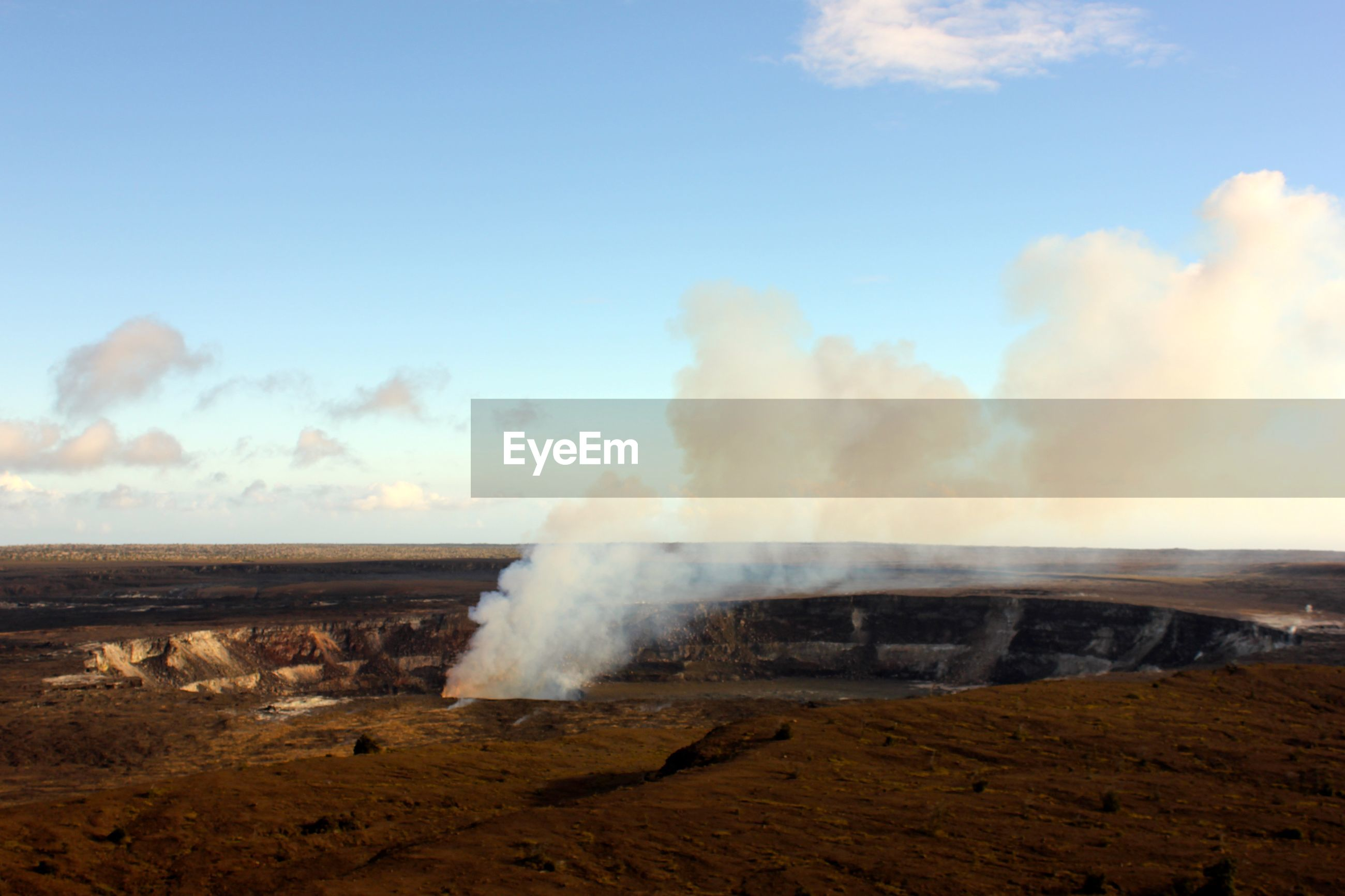 Scenic view of smoke on landscape against sky